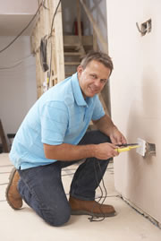 a sparky working on an electrical installation